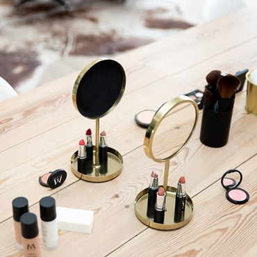Make-up and mirrors on a table